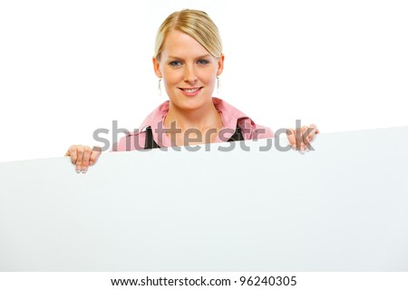 Happy woman showing blank billboard - stock photo
