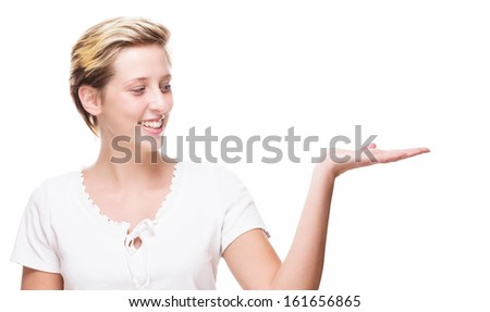 happy woman showing empty hand for product placement on white background - stock photo