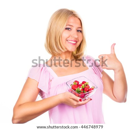 Happy woman showing fresh strawberries