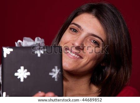 Happy woman showing her christmas present - stock photo