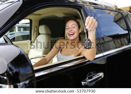happy woman showing keys of her new expensive status car - stock photo
