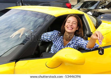happy woman showing sitting inside of her new yewllo sports car
