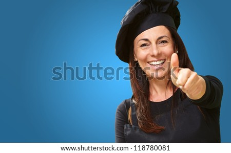 Happy Woman Showing Thumb Up On Blue Background - stock photo