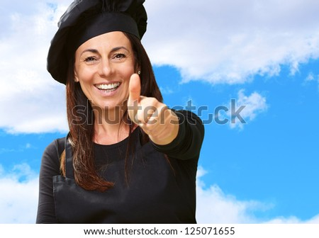 Happy Woman Showing Thumb Up, Outdoor - stock photo