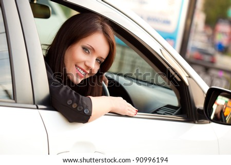 happy  woman sitting in white car