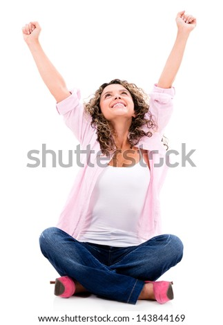 Happy woman sitting with arms up - isolated over a white background - stock photo