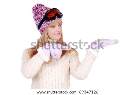 Happy woman skier pointing with her hand in gloves