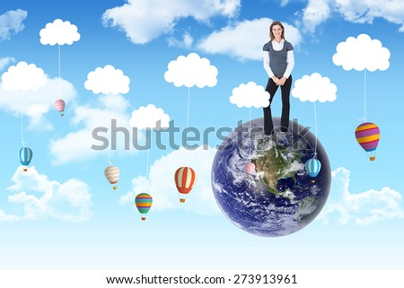 Happy woman smiling at camera against hot air balloons hanging from clouds - stock photo