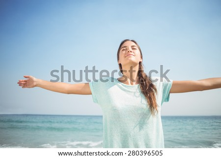 happy woman smiling at the camera at the beach - stock photo