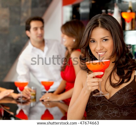 happy woman smiling in a bar or a nightclub - stock photo