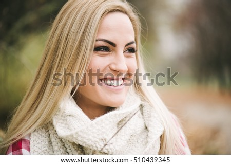 Happy woman smiling outdoor