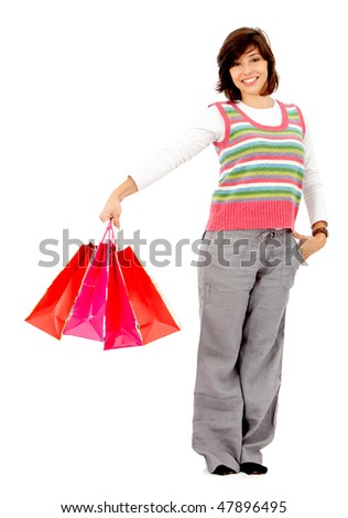happy woman smiling with shopping bags isolated over a white background - stock photo