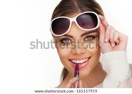 happy woman smoking e-cigarette wearing sunglasses - stock photo