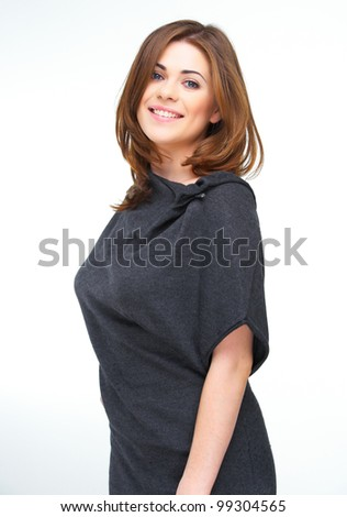 Happy woman standing against white background. Confident model pose with lowered hands