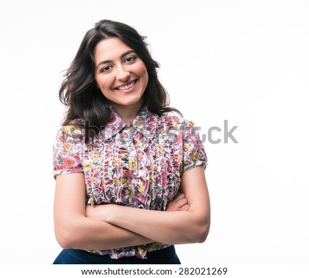 Happy woman standing with arms folded isolated on a white background. Looking at camera