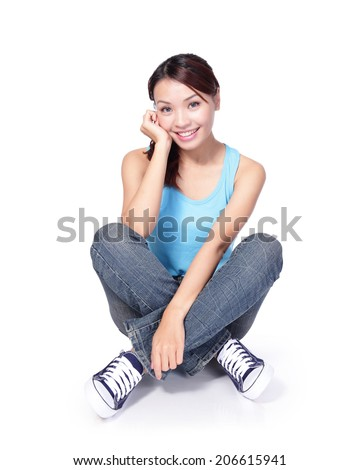 Happy woman student sitting on floor isolated on white background. asian - stock photo