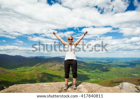 Happy woman successfully hiking Old Rag mountain in Shenandoah National Park in Virginia - stock photo
