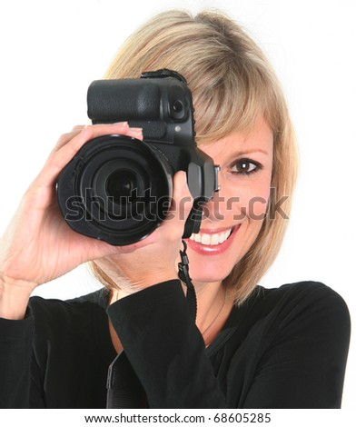 Happy woman taking a photo with a professional digital camera. - stock photo