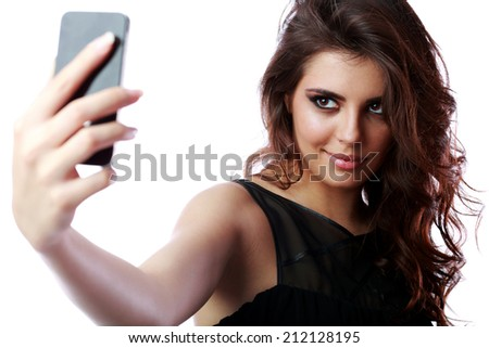 Happy woman taking self picture with smartphone camera - stock photo