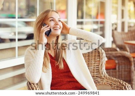 Happy woman talking on the smartphone outdoors - stock photo
