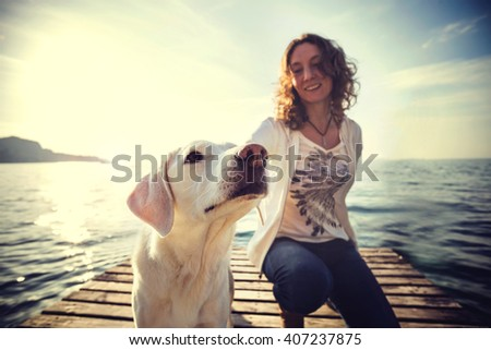 happy woman to have fun together with her dog - stock photo