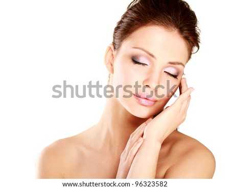 Happy woman touching her face isolated on white background - stock photo