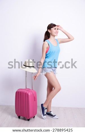 Happy woman tourist travel smile with white concrete wall and wood floor, asian beauty - stock photo