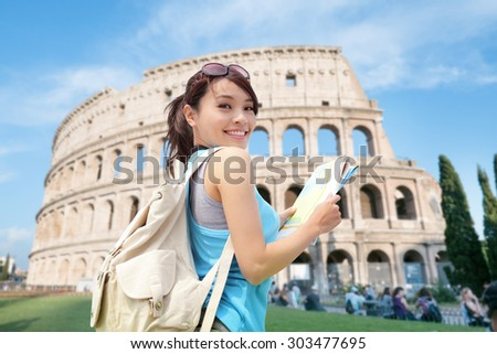Happy woman travel in Colosseum in Rome, Italy - stock photo