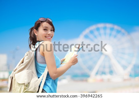 Happy woman travel with ferris wheel, hong kong, asian beauty - stock photo