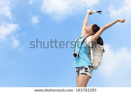 Happy woman traveler relax feel free with sky background - stock photo