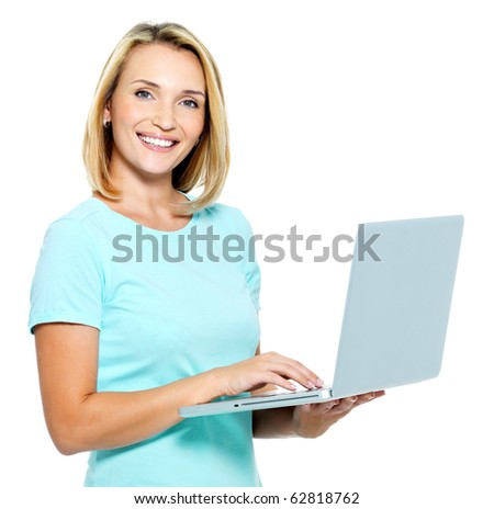 Happy woman typing  on the laptop - isolated on white - stock photo