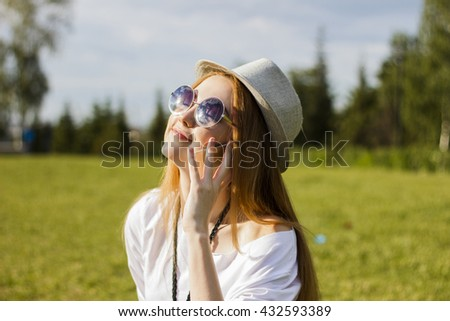 Happy woman using the phone