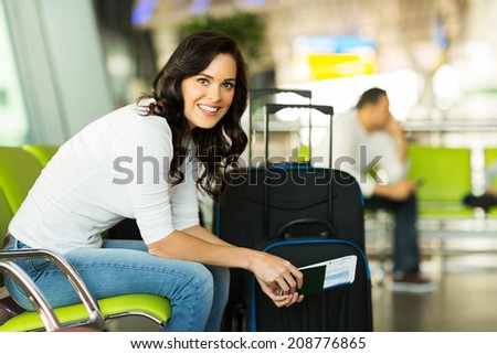 happy woman waiting for flight at airport - stock photo