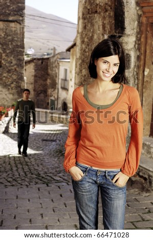 Happy woman waiting for her man - stock photo