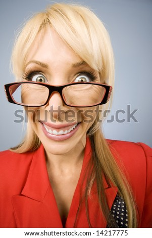 Happy woman wearing glasses in red with a big smile - stock photo