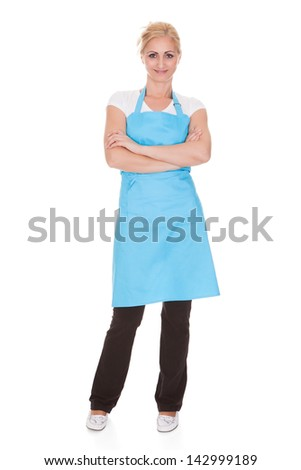 Happy Woman Wearing Kitchen Apron Over White Background - stock photo