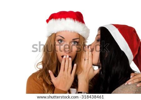 happy woman whisper in Santa Claus hat  - stock photo
