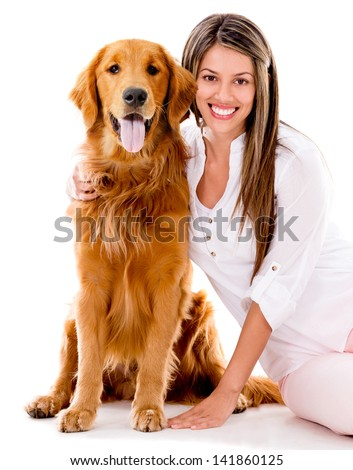Happy woman with a beautiful dog - isolated over white background - stock photo