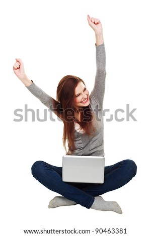 Happy woman with a laptop isolated over a white background - stock photo