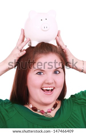 Happy woman with a piggy bank - stock photo