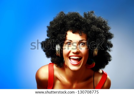 Happy woman with afro hairstyle wear headphones - stock photo