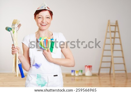 Happy woman with brushes and different colors painting wall in a room (3D Rendering of background) - stock photo
