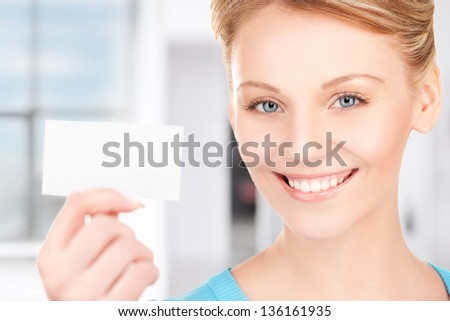 happy woman with business card in office - stock photo