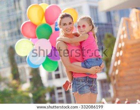 happy woman with child. outdoor family portrait. Mother and daughter outdoors.  - stock photo