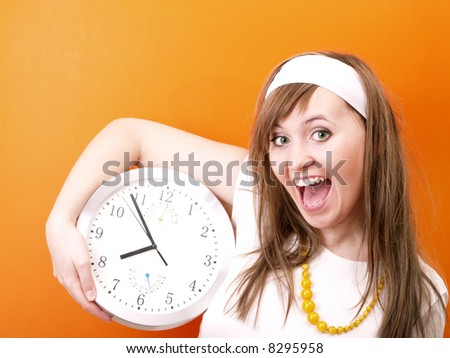Happy woman with clock in hand. - stock photo