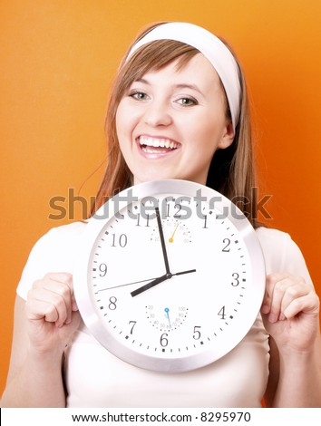 Happy woman with clock in hands.