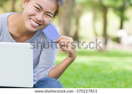 happy woman with credit card and laptop new lifestyle easy payment shopping online - stock photo