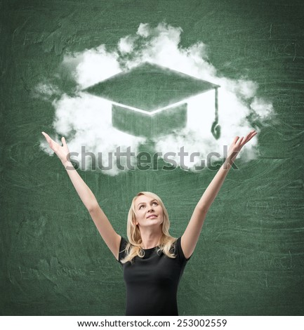 happy woman with drawing bachelor hat on green  chalk board, - stock photo
