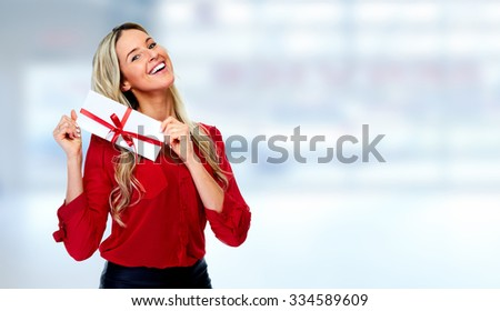 Happy  woman with envelope over blue banner background. - stock photo