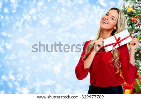 Happy  woman with envelope over Christmas background. - stock photo